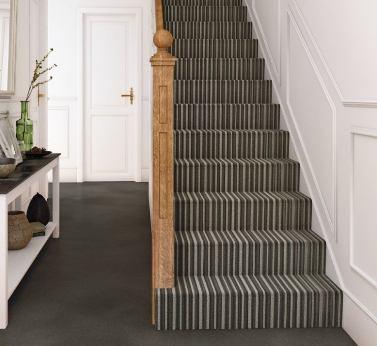Striped carpet going up Victorian stairs